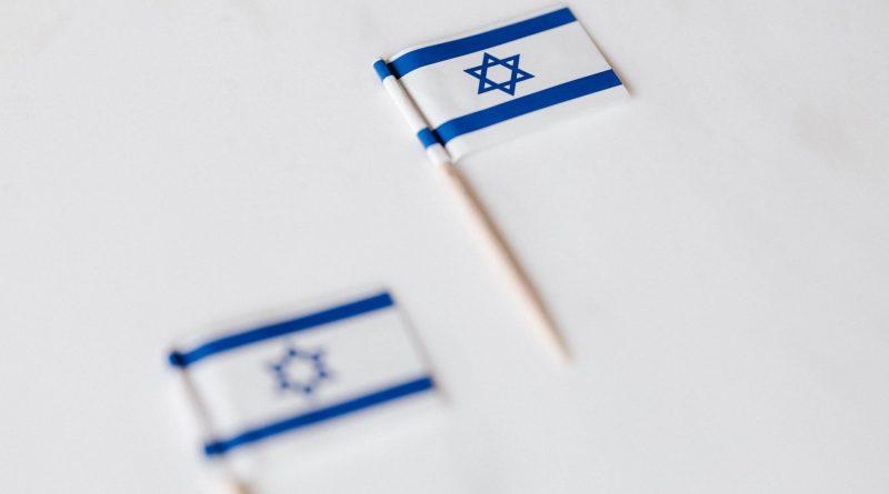 israel miniature flag on white surface