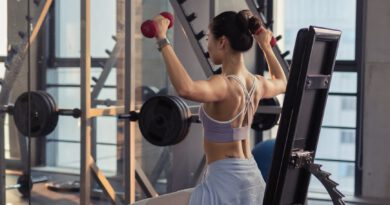 photo of woman raising dumbbells